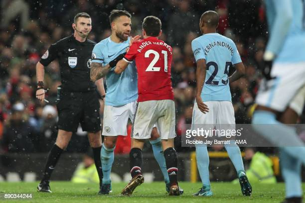 Nicolas Otamendi of Manchester City and Ander Herrera of Manchester United have a disagreement during the Premier League match between Manchester...