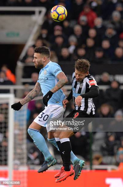Nicolas Otamendi of Manchester City and Dwight Gayle of Newcastle United challenge for the ball during the Premier League match between Newcastle...