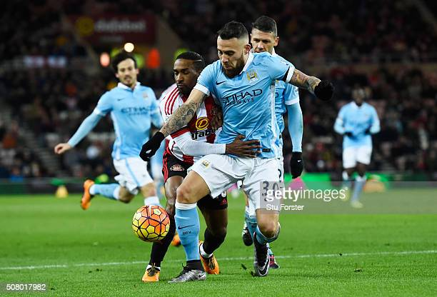 Nicolas Otamendi of Manchester City and Jermain Defoe of Sunderland compete for the ball during the Barclays Premier League match between Sunderland...