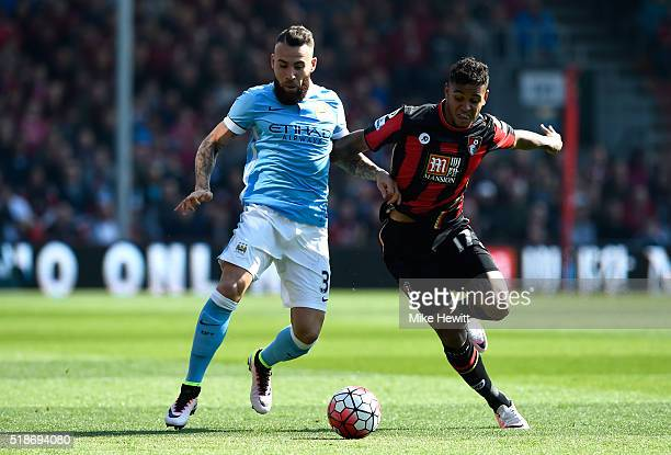 Nicolas Otamendi of Manchester City and Joshua King of Bournemouth compete for the ball during the Barclays Premier League match between AFC...