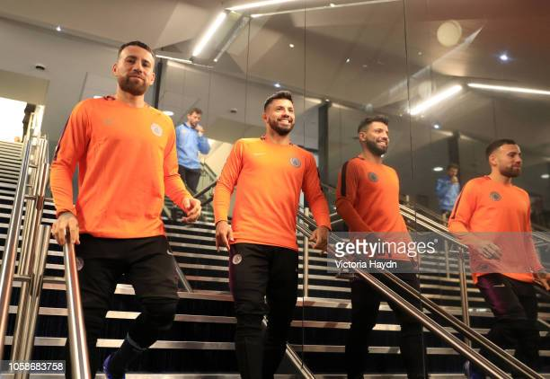 Nicolas Otamendi of Manchester City and Sergio Aguero of Manchester City walk down the tunnel to warm up prior to the Group F match of the UEFA...
