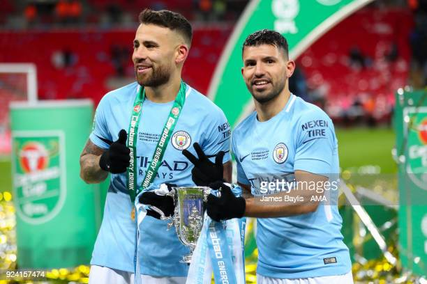 Nicolas Otamendi of Manchester City and Sergio Aguero of Manchester City celebrate with the Carabao Cup trophy during the Carabao Cup Final match...