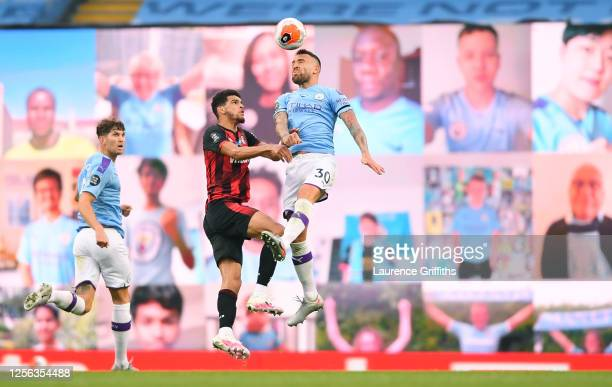 Nicolas Otamendi of Manchester City battles for possession with Dominic Solanke of AFC Bournemouth in front of the fan wall during the Premier League...