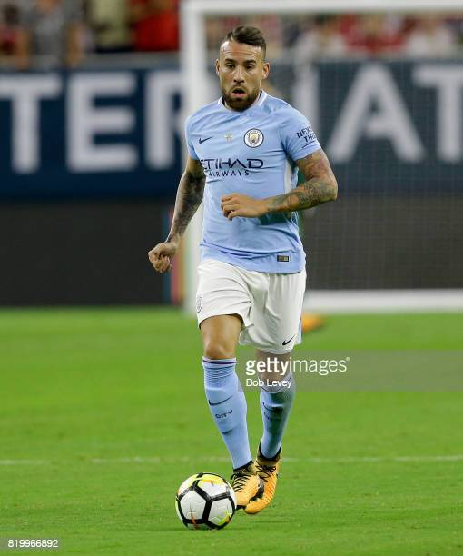 Nicolas Otamendi of Manchester City brings the ball up the pitch in the second half against Manchester United at NRG Stadium on July 20 2017 in...