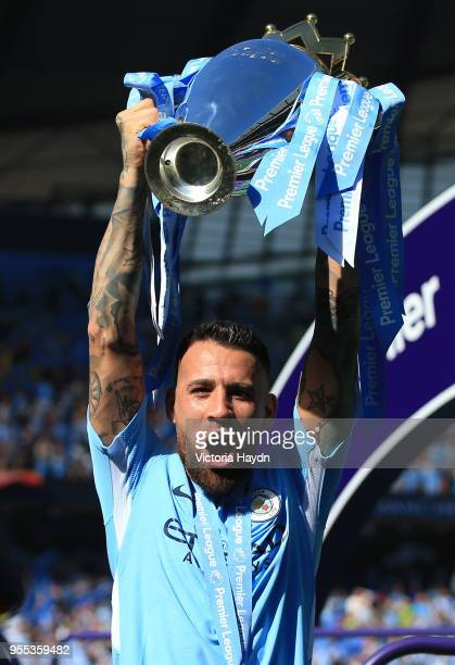 Nicolas Otamendi of Manchester City celebrate with The Premier League Trophy after the Premier League match between Manchester City and Huddersfield...