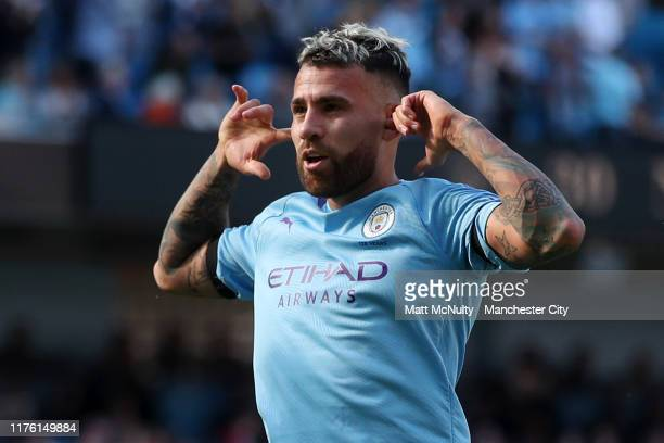 Nicolas Otamendi of Manchester City celebrates after scoring his team's fifth goal during the Premier League match between Manchester City and...
