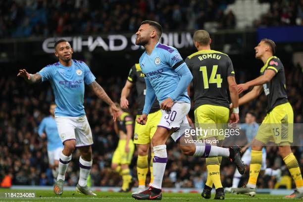 Nicolas Otamendi of Manchester City celebrates after scoring his team's first goal during the Carabao Cup Round of 16 match between Manchester City...