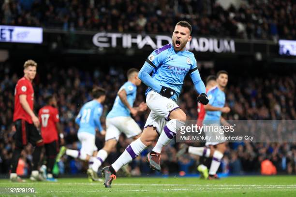 Nicolas Otamendi of Manchester City celebrates after scoring his team's first goal during the Premier League match between Manchester City and...