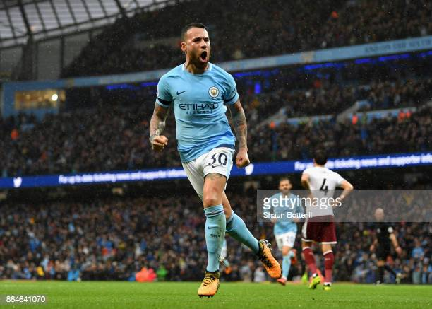 Nicolas Otamendi of Manchester City celebrates as he scores the 2nd Manchester City goal with a header during the Premier League match between...