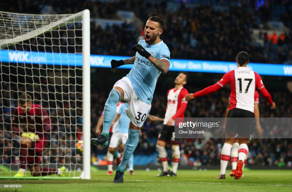 Nicolas Otamendi of Manchester City celebrates his sides first goal as Virgil van Dijk of Southampton scored a own goal during the Premier League match between Manchester City and Southampton at Etihad Stadium on November 29, 2017 in Manchester, England.