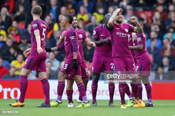 Nicolas Otamendi of Manchester City celebrates scoring his sides fourth goal with his Manchester City team mates during the Premier League match...