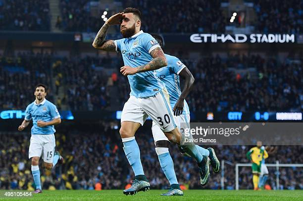 Nicolas Otamendi of Manchester City celebrates scoring his team's first goal during the Barclays Premier League match between Manchester City and...