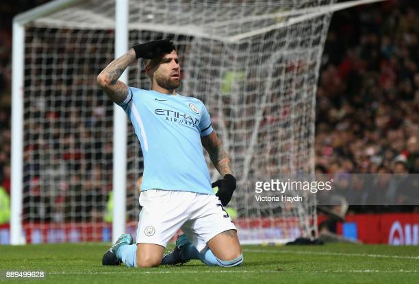 Nicolas Otamendi of Manchester City celebrates scoring the 2nd Manchester City goal during the Premier League match between Manchester United and...