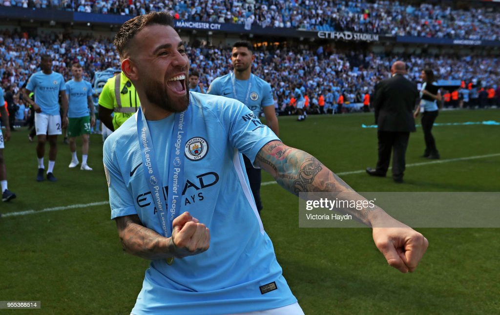 https://media.gettyimages.com/photos/nicolas-otamendi-of-manchester-city-celebrates-winning-the-premier-picture-id955368514