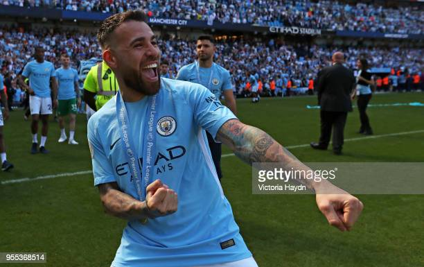 Nicolas Otamendi of Manchester City celebrates winning the premier league after the Premier League match between Manchester City and Huddersfield...
