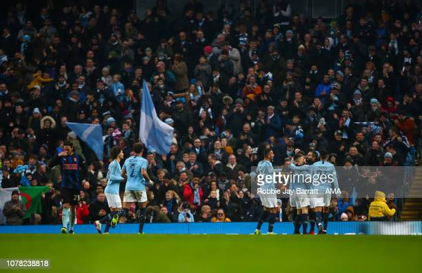 Nicolas Otamendi of Manchester City celebrates with his team mates after scoring a goal to make it 60 during the FA Cup Third Round match between...