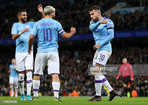 Nicolas Otamendi of Manchester City celebrates with Riyad Mahrez and Sergio Aguero after scoring his team's first goal during the Carabao Cup Round...