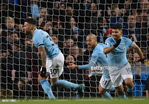Nicolas Otamendi of Manchester City celebrates with team mates David Silva of Manchester City and Sergio Aguero of Manchester City after scoring his...