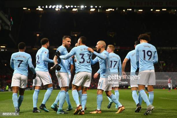 Nicolas Otamendi of Manchester City celebrates with team matesafter scoring the winning goal during the Premier League match between Manchester...