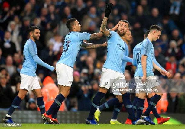 Nicolas Otamendi of Manchester City celebrates with teammates after scoring his team's sixth goal during the FA Cup Third Round match between...