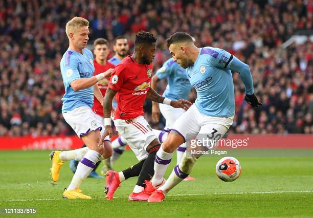 Nicolas Otamendi of Manchester City challenges Fred of Manchester United in the penalty box before Fred is booked for simulation during the Premier...