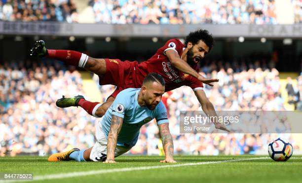 Nicolas Otamendi of Manchester City fouls Mohamed Salah of Liverpool during the Premier League match between Manchester City and Liverpool at Etihad...
