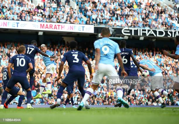 Nicolas Otamendi of Manchester City heads a ball on to the arm of team mate Aymeric Laporte leading to Gabriel Jesus of Manchester City scoring his...