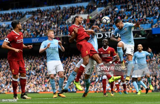 Nicolas Otamendi of Manchester City heads the ball clear during the Premier League match between Manchester City and Liverpool at Etihad Stadium on...