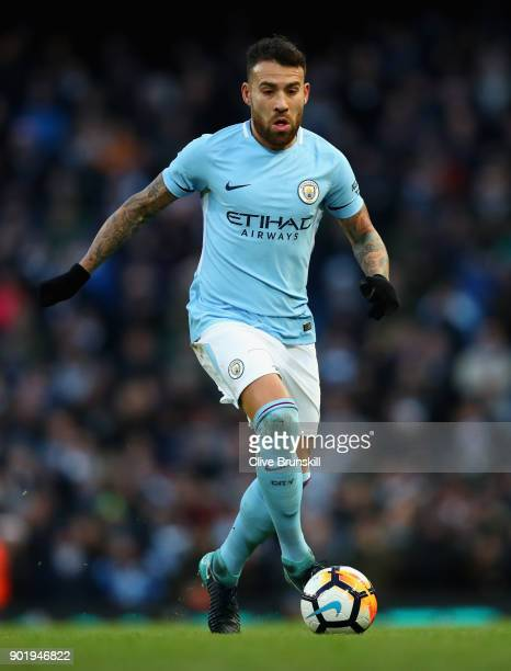 Nicolas Otamendi of Manchester City in action during The Emirates FA Cup Third Round match between Manchester City and Burnley at Etihad Stadium on...