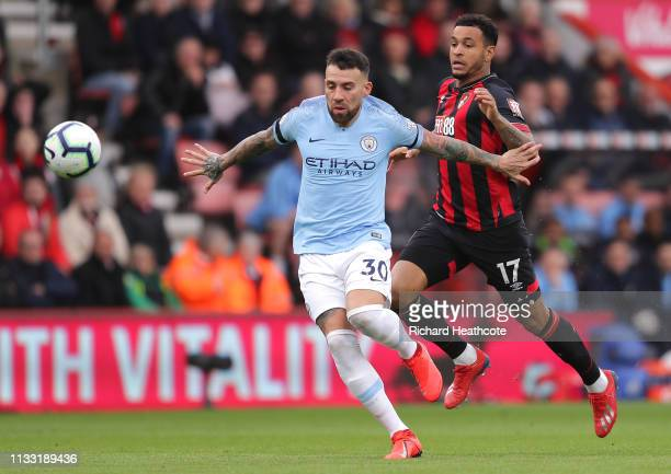 Nicolas Otamendi of Manchester City is challenged by Joshua King of AFC Bournemouth during the Premier League match between AFC Bournemouth and...
