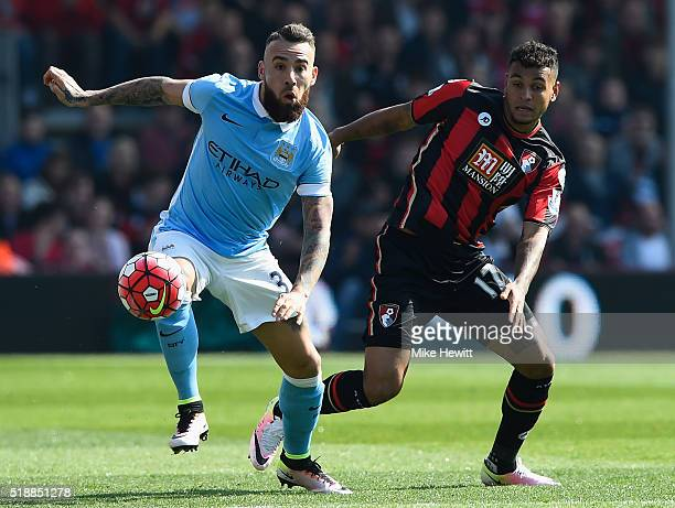 Nicolas Otamendi of Manchester City is challenged by Joshua King of Bournemouth during the Barclays Premier League match between AFC Bournemouth and...