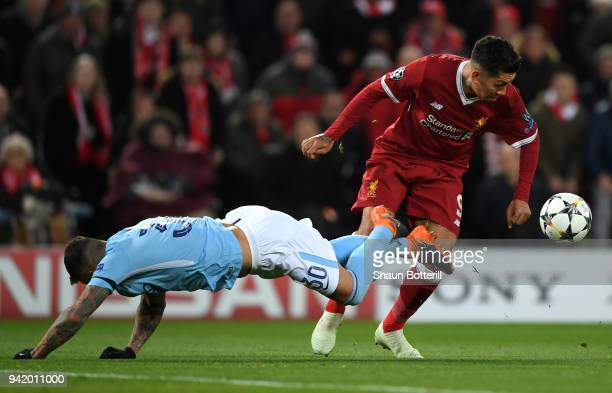 Nicolas Otamendi of Manchester City is challenged by Roberto Firmino of Liverpool during the UEFA Champions League Quarter Final Leg One match...