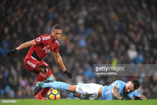 Nicolas Otamendi of Manchester City is fouled by Richarlison de Andrade of Watford during the Premier League match between Manchester City and...