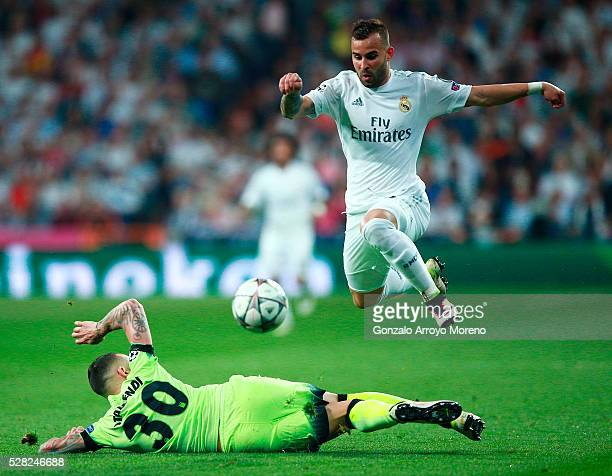 Nicolas Otamendi of Manchester City makes a tackle on Jese of Real Madrid during the UEFA Champions League semi final second leg match between Real...