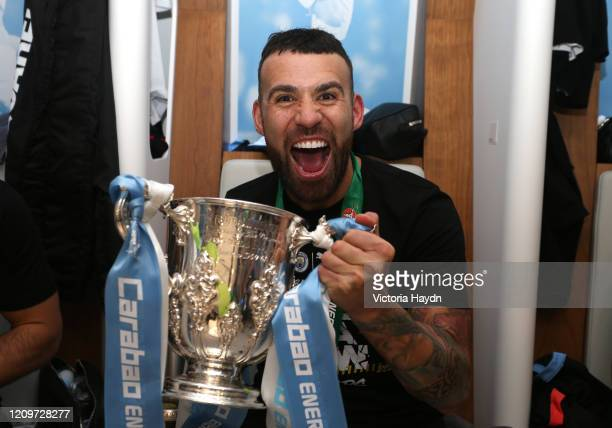 Nicolas Otamendi of Manchester City poses with the trophy in the dressing room after the Carabao Cup Final between Aston Villa and Manchester City at...