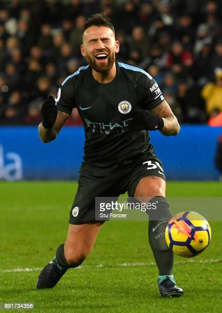 Nicolas Otamendi of Manchester City reacts during the Premier League match between Swansea City and Manchester City at Liberty Stadium on December 13...