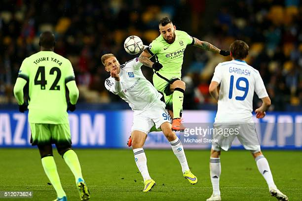 Nicolas Otamendi of Manchester City rises above Lukasz Teodorczyk of Dynamo Kiev to win a header during the UEFA Champions League round of 16 first...