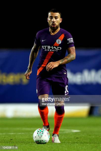 Nicolas Otamendi of Manchester City runs with the ball during the Carabao Cup Third Round match between Oxford United and Manchester City at Kassam...