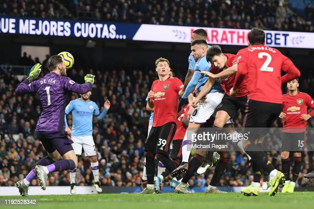 Nicolas Otamendi of Manchester City scores his team's first goal during the Premier League match between Manchester City and Manchester United at...