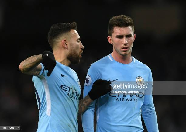 Nicolas Otamendi of Manchester City speaks to Aymeric Laporte of Manchester City during the Premier League match between Manchester City and West...