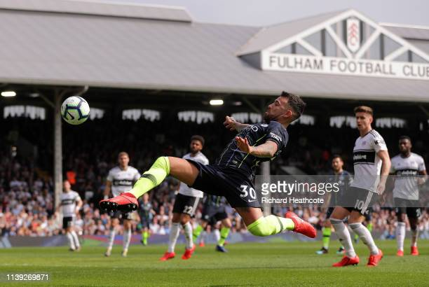 Nicolas Otamendi of Manchester City stretches to reach the ball during the Premier League match between Fulham FC and Manchester City at Craven...