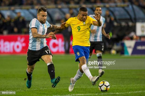 Nicolas Otamendi of the Argentinan National Football Team and Gabriel Jesus of the Brazilian National Football Team contest the ball during the...