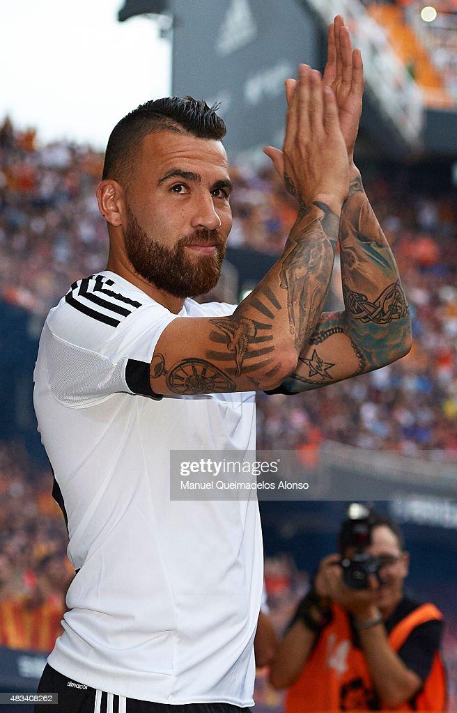 Nicolas Otamendi of Valencia waves during the team official presentation ahead the pre-season friendly match between Valencia CF and AS Roma at Estadio Mestalla on August 8, 2015 in Valencia, Spain.