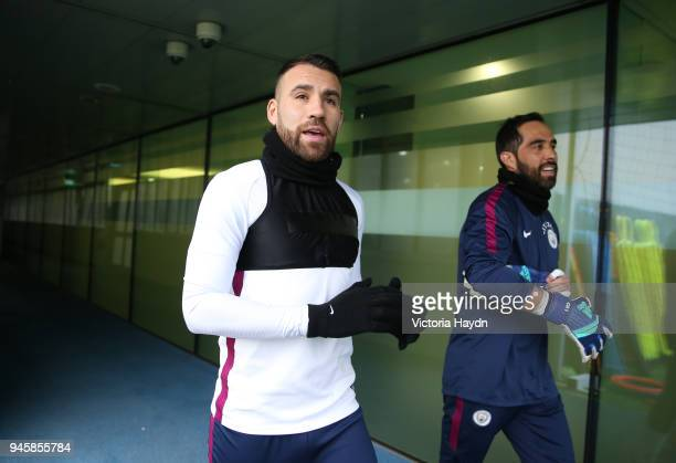 Nicolas Otamendi reacts walking to training during a training session at Manchester City Football Academy on April 13 2018 in Manchester England