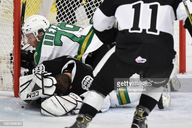 Nicolas Ouellet of the ValdOr Foreurs falls onto goaltender Emile Samson of the BlainvilleBoisbriand Armada during the QMJHL game at Centre...