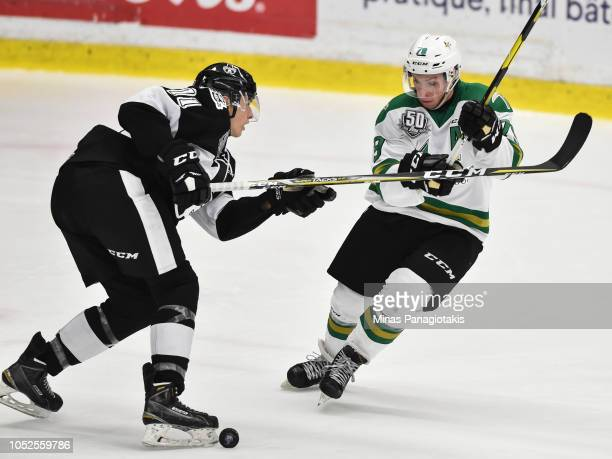 Nicolas Ouellet of the ValdOr Foreurs tries to get the puck past Simon Lavigne of the BlainvilleBoisbriand Armada during the QMJHL game at Centre...
