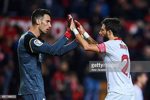Nicolas Pareja and Sergio Rico of Sevilla FC celebrates after winning the match against Real Madrid CF during the La Liga match between Sevilla FC...