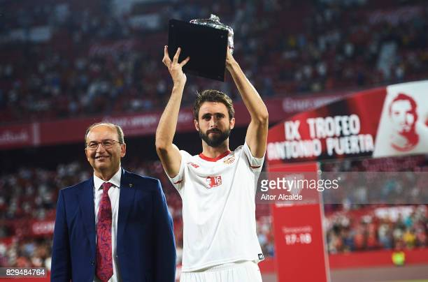 Nicolas Pareja of Sevilla FC and President of Sevilla FC Pepe Castro poses with the trophy after win AS Roma during a Pre Season Friendly match...