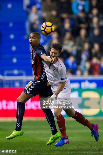 Nicolas Pareja of Sevilla FC duels for the ball with Deyverson Brum of Deportivo Alaves during the La Liga match between Deportivo Alaves and Sevilla...