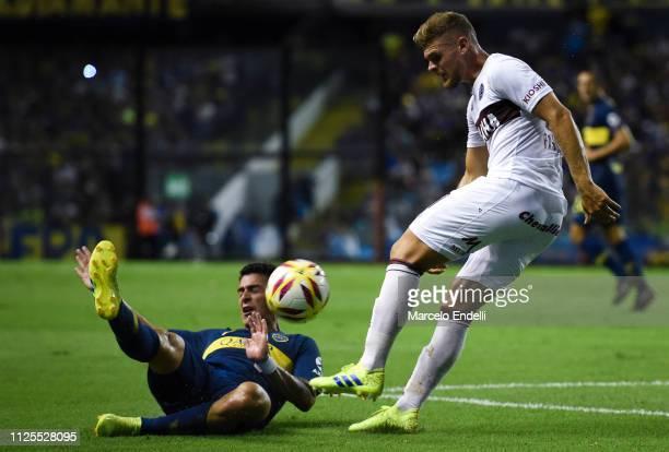 Nicolas Pasquini of Lanus fights for the ball with Cristian Pavon of Boca Juniors during a match between Boca Juniors and Lanus as part of Superliga...